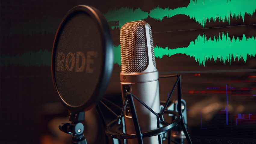 A microphone is setup with a pop shield to record a Voiceover or Audio Description session.