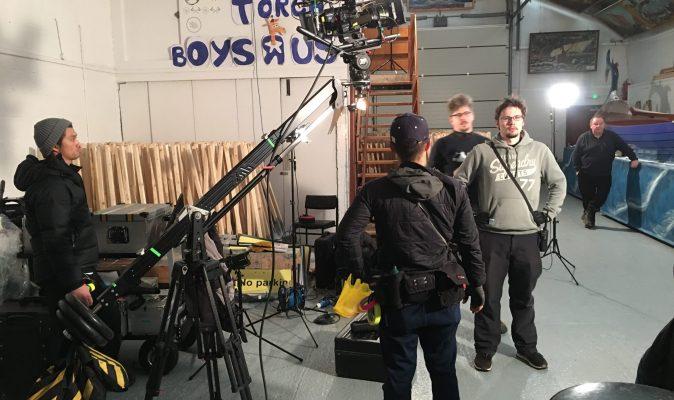 Crew stand around a camera jib in Shetland.